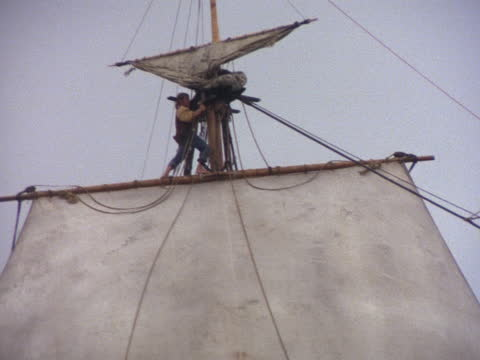 a galleon crew works the riggings on a 17th century ship. - 17th century stock videos & royalty-free footage