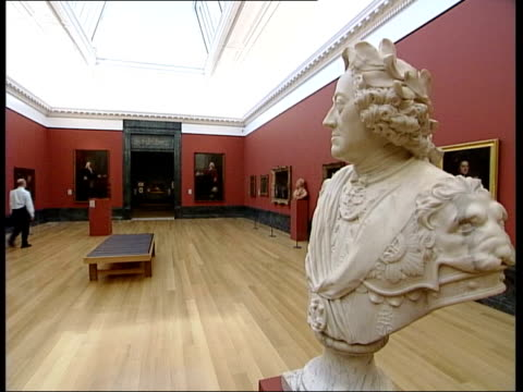 vídeos de stock, filmes e b-roll de tate britain opens following redevelopment naked woman in painting marble statue of nude woman holding drape bust in gallery staircase and gallery... - compasso