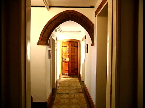 galleries and museums: william morris house bought by national trust; int windows, with stained glass panels featuring angel, birds, flowers corridor... - national trust video stock e b–roll