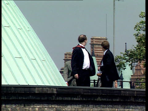 plans for british museum and british library; ext photographers on roof taking pics architect sir norman foster and dr robert anderson along towards... - british museum stock videos & royalty-free footage