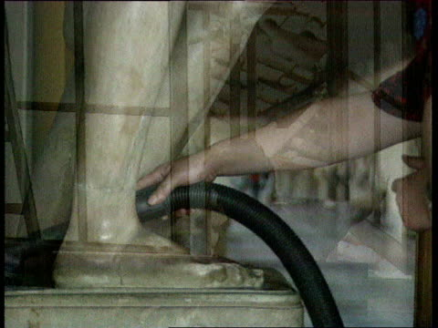 uffizi gallery renovations; to be shotlisted in full italy: florence: uffizi: int woman dusting statue woman opening window woman hoovering the legs... - florenz stock-videos und b-roll-filmmaterial