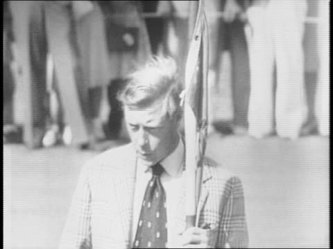 gallery crowd progresses along golf fairway / edward duke of windsor stands on golfing green as referee / duchess of windsor stands among gallery... - edward viii stock videos & royalty-free footage