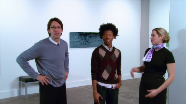 gallery owner, curator, and artist discussing exhibition - curator stock videos & royalty-free footage