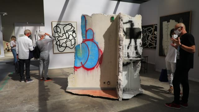 gallery owner shows a visitor a work of urban art press preview of art paris 2020, contemporary art fair on september 9, 2020 in paris, france. art... - museum stock videos & royalty-free footage