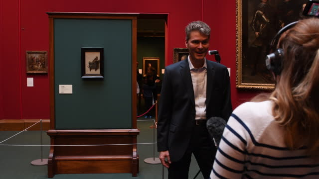 Gallery staff view the painting by Carel Fabritius the Goldfinch at the Scottish National Gallery on November 11 2016 The Goldfinch is one of the...
