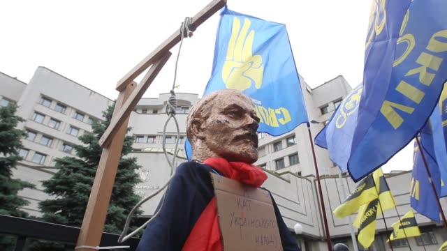 gallows and a sculpture of soviet leader vladimir lenin with a placards reading like ''i am the executioner of the ukrainian people' are seen during... - executioner stock videos & royalty-free footage