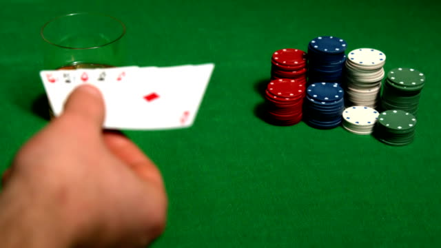 gambler putting his full house poker hand on table - casino cards stock videos & royalty-free footage