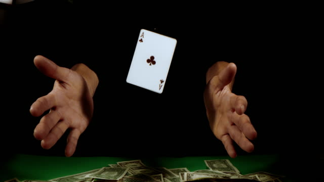 slo mo gambler spinning a club ace card - hand of cards stock videos & royalty-free footage