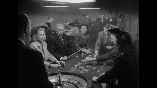 1948 cu gamblers in casino in deep thought - blackjack stock videos and b-roll footage