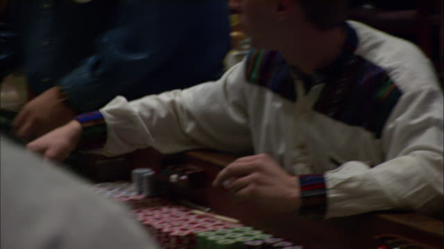 gamblers play craps in a casino. - craps stock videos & royalty-free footage