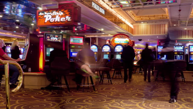 t/l  gamblers sitting at slot machines in casino / las vegas, nevada, usa - casino stock videos & royalty-free footage