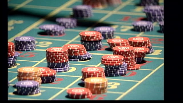 brown announces review of supercasino plans; r30080601 england: int roulette wheel spinning in casino anonymous gamblers placing chips on table close... - croupier stock videos & royalty-free footage
