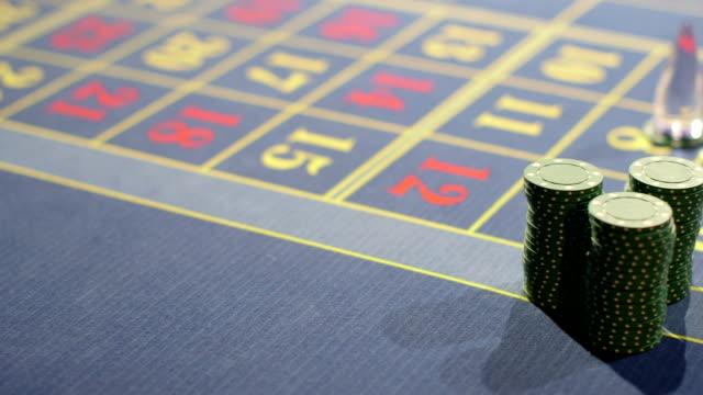 vídeos de stock e filmes b-roll de gambling chips piled into stacks ready for betting - ficha de apostas