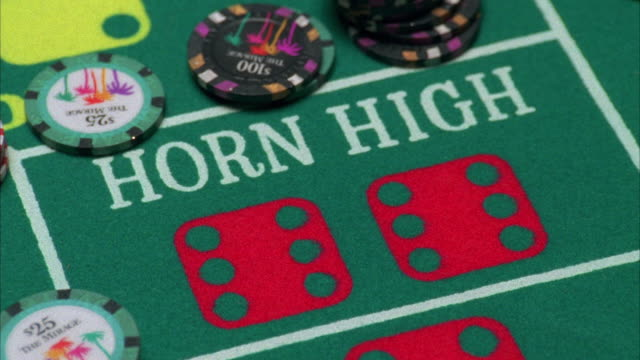 cu gambling chips tossed on 'horn high' of craps table / las vegas, nevada, usa - craps stock videos & royalty-free footage