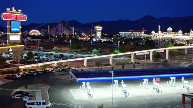 t/l ws gambling resort primm at night with casinos and gas station straddling interstate 15 and monorail which bridges the interstate at nevada state line / primm, nevada, usa - casino night stock videos & royalty-free footage