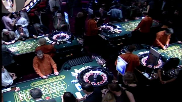 think tank favours blackpool casino bid over millennium dome date unknown location unknown int high angle view of casino tables croupiers and... - card table stock videos & royalty-free footage