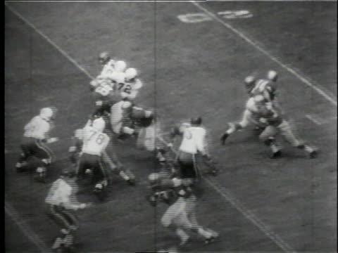 vídeos de stock e filmes b-roll de game clock / game in play - 1958