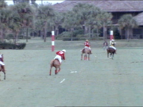 vídeos de stock, filmes e b-roll de game in play far end of field zi ws player tapping ball up field racing hard back down field holding mallet up while riding blocked amp jostled by... - polo shirt