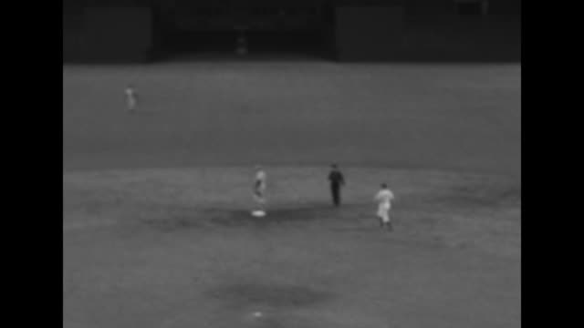 vídeos de stock e filmes b-roll de game in progress / boxers joe walcott rocky marciano in new york yankees uniforms / runner scores in oldtimers' day game - camisola de basebol