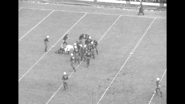 game in progress with packed grandstands at harvard stadium as the harvard crimson plays the yale bulldogs kickoff various drives down field... - 1929 stock videos & royalty-free footage
