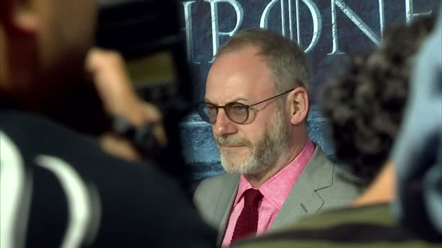 'game of thrones' season 6 world premiere takes place in hollywood california shows actors liam cunningham who portrays davos seaworth in the show as... - liam cunningham stock videos & royalty-free footage