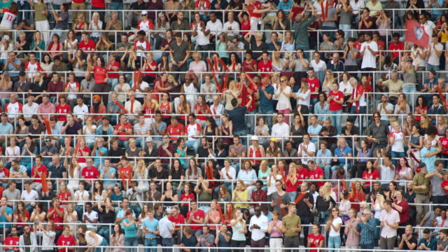 ld game spectators cheering and applauding in their seats at the stadium - stadion stock-videos und b-roll-filmmaterial