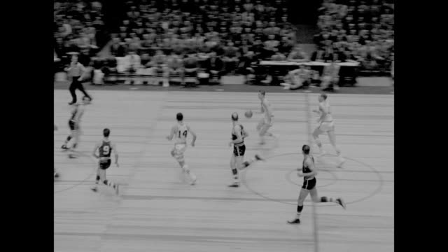 vs game with robert cousy boston celtics #4 adolph schayes syracuse nationals #5 paul seymour syracuse nationals making long shots and fancy plays /... - syracuse stock videos & royalty-free footage