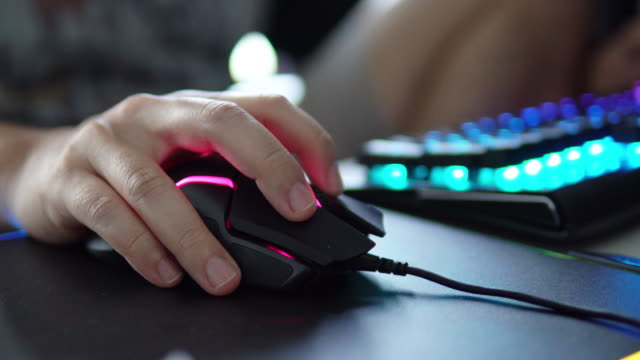 gamer hand playing computer games on mouses. - computer mouse stock videos & royalty-free footage