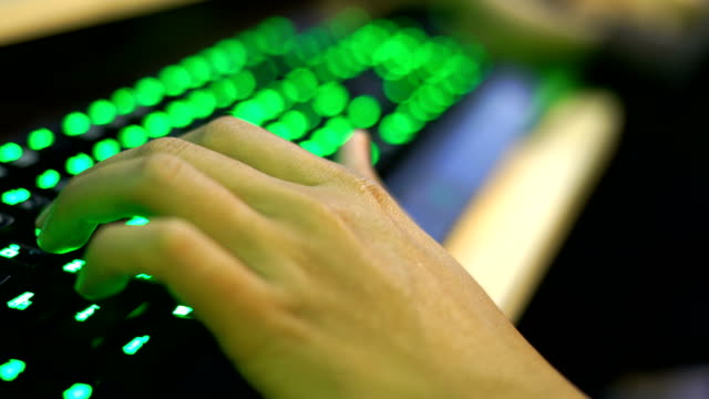 gamer hand playing game with green desktop pc keyboard - microsoft stock videos and b-roll footage