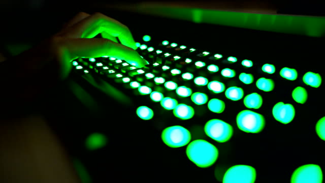 CU Gamer Hand pressing LED green keyboard button in gaming