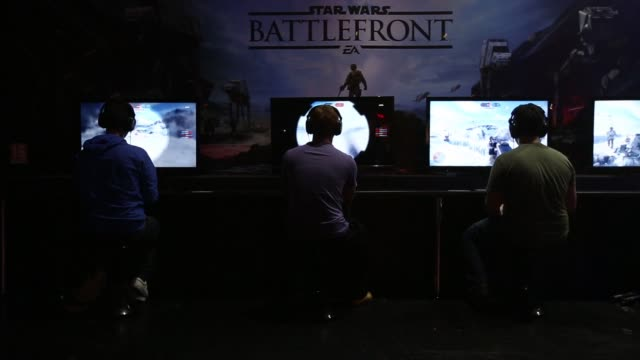 gamers play the video game star wars battlefront produced by electronic arts inc at the egx 2015 video gaming conference in birmingham uk on thursday... - xbox stock videos & royalty-free footage