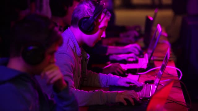 gamers play video games on laptop computers at the dreamhack digital festival in moscow russia on saturday dec 5 2015 - wettbewerb unterhaltungsveranstaltung stock-videos und b-roll-filmmaterial