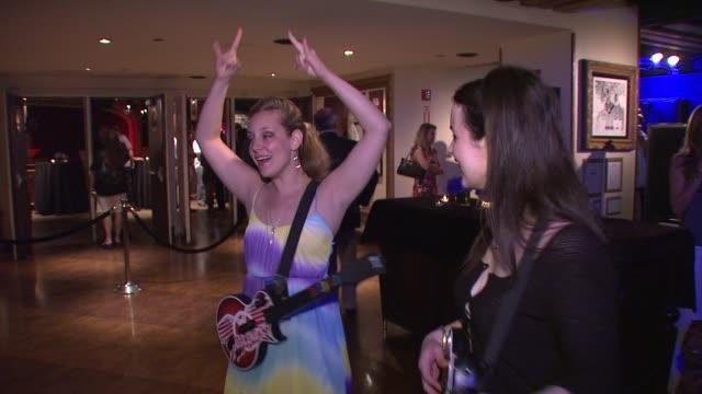gamers playing guitar hero at the aerosmith launches new guitar hero at new york ny. - エアロスミス点の映像素材/bロール