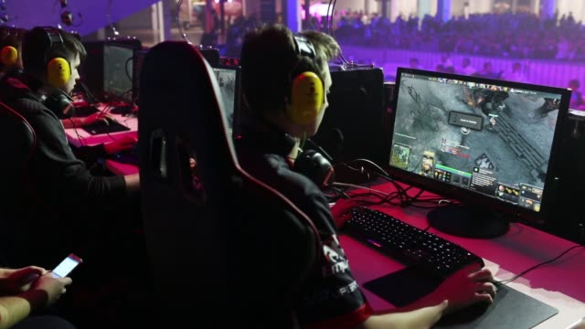 gamers wearing headphones play video games on desktop computers as attendees watch at the dreamhack digital festival in moscow russia on saturday dec... - contestant stock videos & royalty-free footage