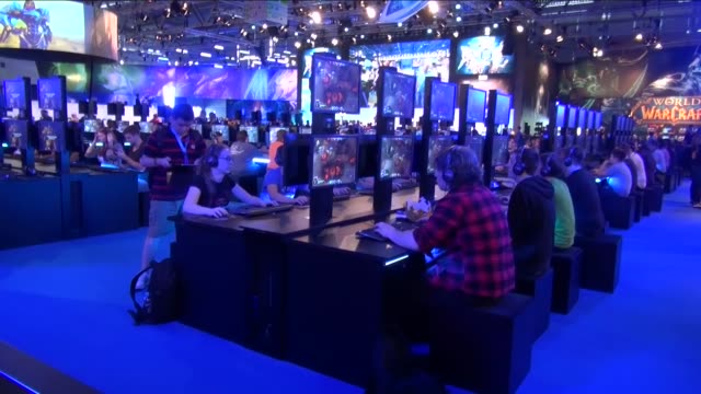 Gaming enthusiasts attend world's one of the largest trade fair Gamescom gaming fair in Cologne Germany on August 05 2014 Thousands of visitors will...