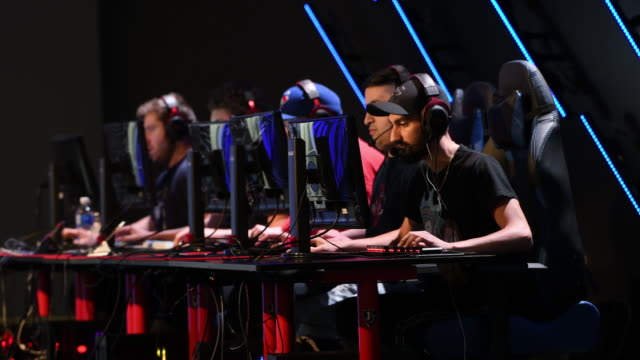 vídeos de stock, filmes e b-roll de gaming stadium and large e-sports tournament for go in vancouver, british columbia, canada on sunday, june 14, 2019. - contestant