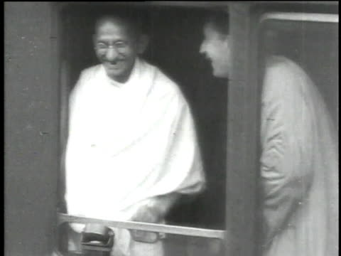 ms gandhi joking and smiling / ws gandhi speaking and sitting on bed surrounded by men in western suits sitting and speaking in return - mahatma gandhi stock videos & royalty-free footage