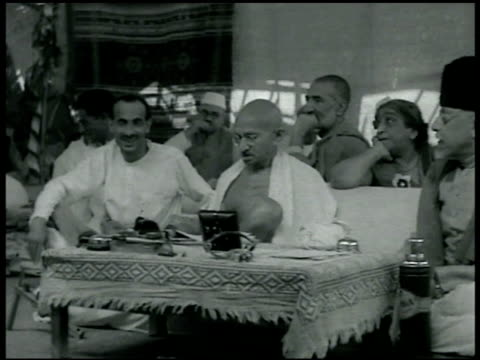 gandhi seated w/ covered low table in front of him fg others seated bg side maulana azad almost out of frame ghaffer khan bg man on left unidentified - mahatma gandhi stock videos & royalty-free footage