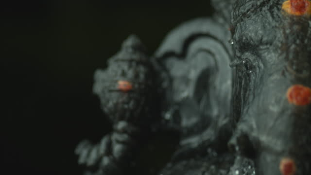 ganesha prayers with water in slow motion - religious celebration stock videos & royalty-free footage