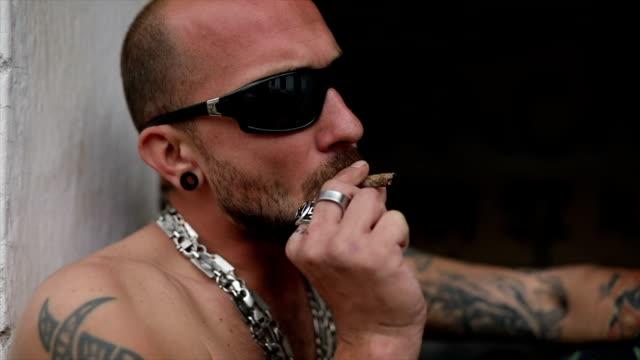 gang member smoking marijuana joint - criminal stock videos & royalty-free footage
