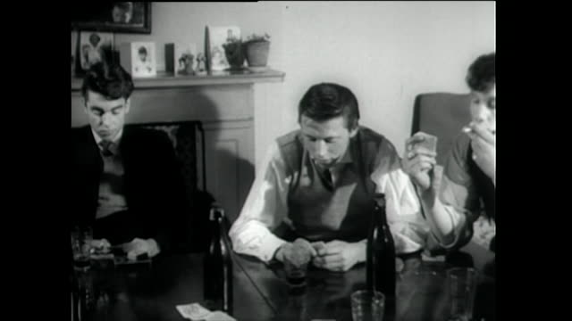 gang of teddy boys play cards together; 1955 - 1955 stock videos & royalty-free footage