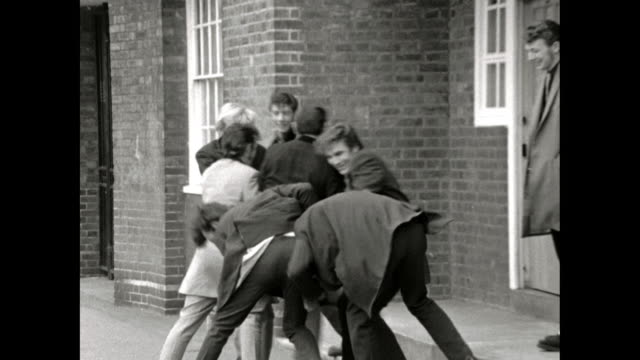 gang of teddy boys play fight with each other - sideburn stock videos & royalty-free footage