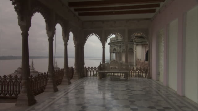 Ganges river seen from balcony with ornate colonnade. Available in HD.
