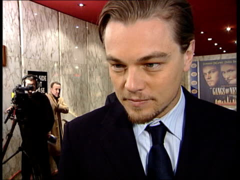 gangs of new york premiere: leonardo dicaprio mobbed; itn int cms leonardo di caprio interview sot - it's pretty intense out there but that's london... - leonardo dicaprio stock videos & royalty-free footage