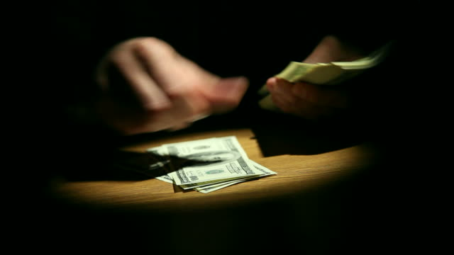 gangster counting money - organized crime stock videos & royalty-free footage