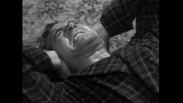 vídeos de stock e filmes b-roll de 1952 a gangster hits his victim's ears - atormentado