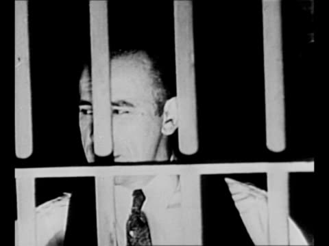 cu gangster john dillinger with facial hair / cleanshaven dillinger in jail cell in tucson az / black / end credits / from greatest headlines of the... - john dillinger stock-videos und b-roll-filmmaterial