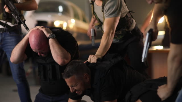 gangsters arrest stock - terrorism stock videos & royalty-free footage