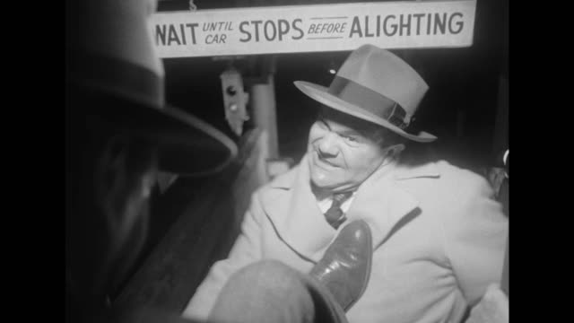 1948 gangsters chase and shoot at panicked man in the city streets before he escapes in a passing trolley - film noir style stock videos and b-roll footage