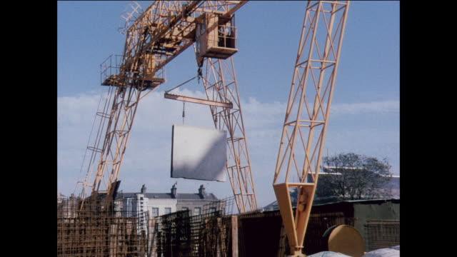LA Gantry crane lifts concrete panels at construction site / UK